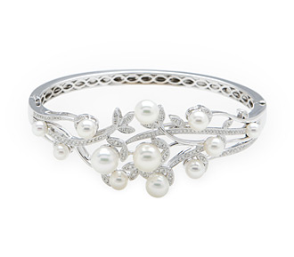 Rent jewelry - Diamonds: .66 TW | Gold: 18K White | Length: 6 1/2 in. | Width: 1  1/8 in.